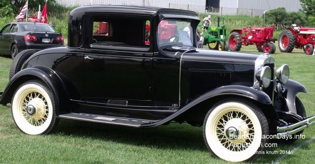 Antique Cars at the Bean and Bacon Days Car Show in Augusta Wisconsin feature this 1920s Ford & 1920s Ford Coupe markmcfarlin.com